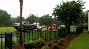 One of the vehicles gets pulled from the mud. Oh wait, the tow truck got stuck. Let's call another one.
