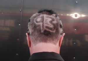 Scott got the coolest haircut around, showing off his bike's entry number.