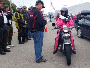 Sharon arrives in her pink rain gear.